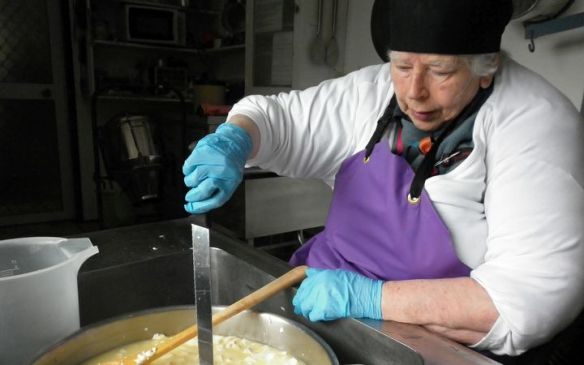 eight_col_biddy_making_cheese